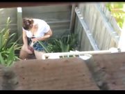Young girl is spied by neighbour while she masturbates outdoor